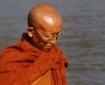Monk crossing river Lisa Daix