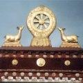 Wheel and Dear on roof of Tibetan Buddhist monastery. Photo © Lisa Diax