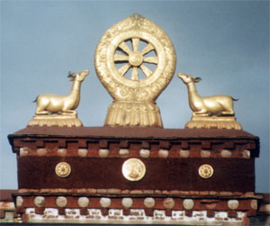 Wheel and Dear on roof of Tibetan Buddhist monastery. Photo © Lisa Diax