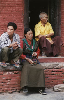 Tibetan family on step. Photo © Lisa Daix