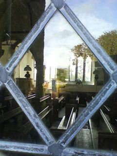 Window View into Widecombe on the moor church. Photo: RSR