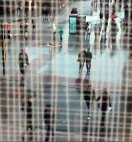 Click to watch the video. Image — Street scene
