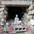 A statue of Kobo Daishi (774–835) guards a tiny hollow at Sankaku-ji representing the cave at Cape Muroto