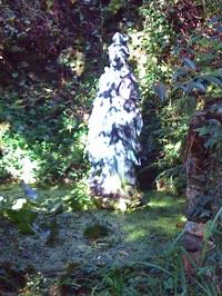 Kuan Yin statue in bright sunlight.
