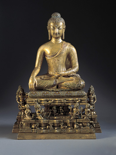 Buddha and Adorants on the Cosmic Mountain  India: Kashmir, c. 700  Bronze with silver and copper inlay  13-1/4 x 9-1/2 x 4-3/4 in. (33.7 x 24.1 x 12.1 cm)  The Norton Simon Foundation