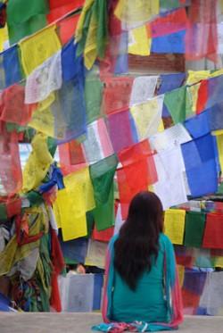 Mustang girl and prayer flags. Photo © Lisa Daix