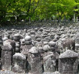 Stone Buddhas Photo © @KyotoDailyPhoto