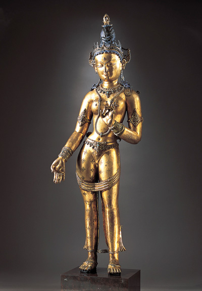 Tara  Nepal or Tibet, c. 1300  Gilt-copper alloy with semiprecious stones and pigment  34 3/4 in x 11 in x 5 1/2 in (88.3 x 27.9 x 14 cm)  The Norton Simon Foundation