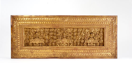 Gilt wood carving, red and black pigment
