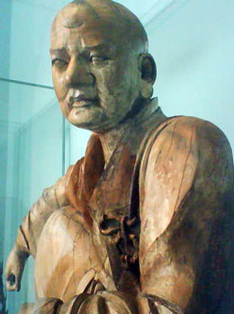 Figure of a Luohan Northern China 1279-1368 AD Wood with traces of paint. V&A