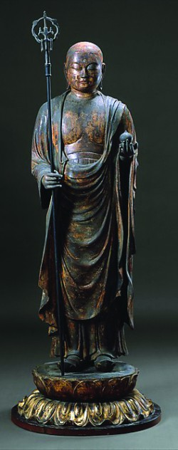 The bodhisattva Jizō dressed as an itinerant monk holds a wish-granting jewel and a monk's staff with six rings