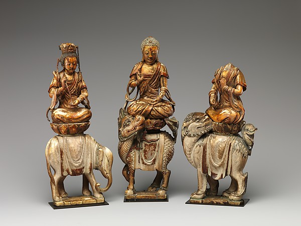 Shakyamuni, seated on a mythical animal known as a qilin and attended by the bodhisattvas Samantabhadhra on an elephant and Manjushri on a lion.