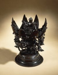 A lotus mandala cast in bronze, with a figure of Aksobhya.