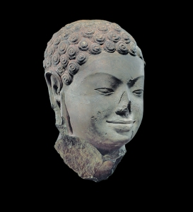 Head of Buddha, Southern Cambodia, 7th century. © Metropolitan Museum of Art.